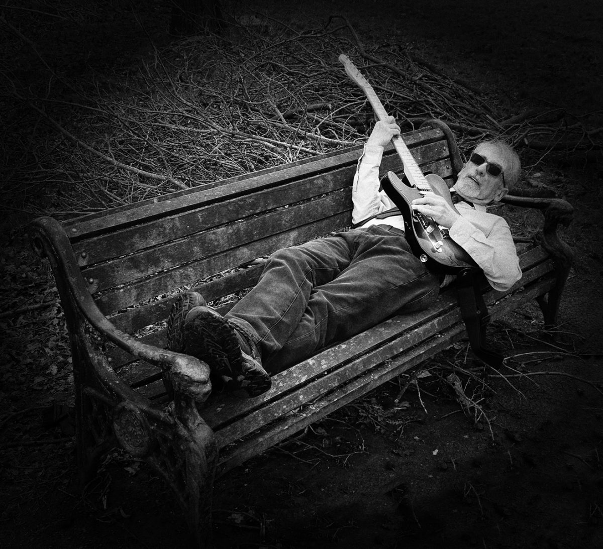 Photo of Mike lying on a park bench, Photograph taken by David White.